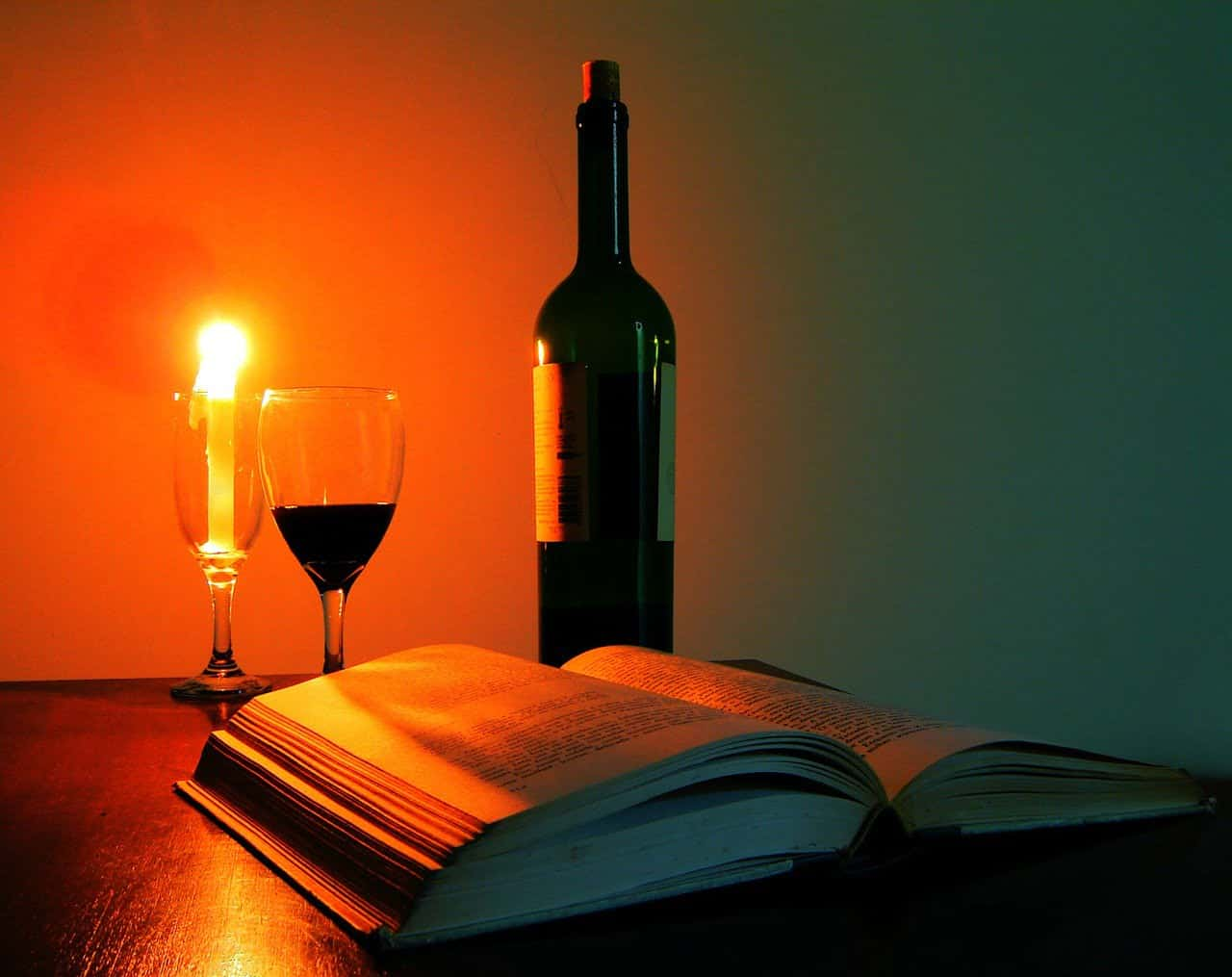 glass of wine, book, candle